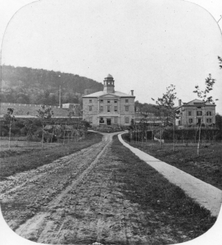 Black and white historical photograph from 1860 featuring the Arts Building at McGill University, photographed by William Notman.