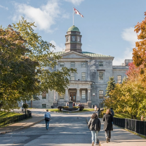 Walkway with students approaching McGill's Arts Building in the autumn