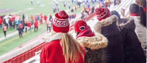 McGill students watching a football game at Percival Molson Memorial Stadium