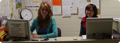 Picture of Albane and Fei behind the help desk