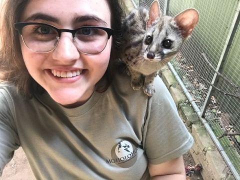 former McGill student Oceanna smiling with a genet