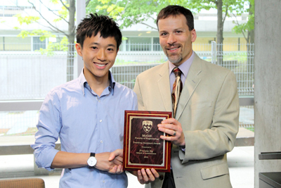 Francis Ng receives TA award from Interim Dean Andrew Kirk (Owen Egan)