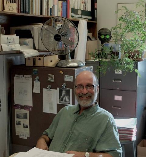 David Krawitz at his desk smiling at the camera.