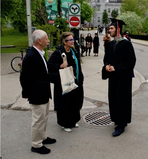 David and Annmarie chat with Juan after convocation ceremony