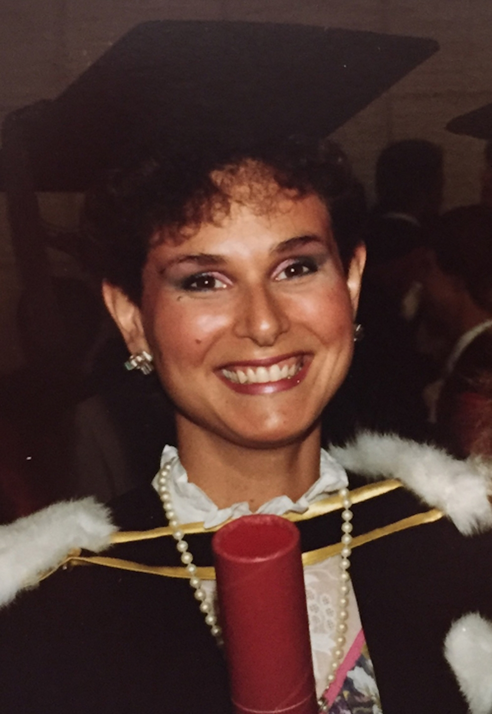 Rochelle Barr smiling at her graduation.