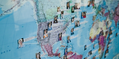 Image of a map with photos and names of the interns pinned to it