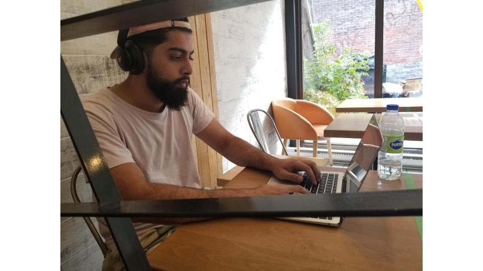 Hussain Awan working remotely.