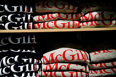 Shelves of McGill sweatshirts at the Bookstore.