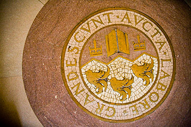 The McGill crest in the floor of the Arts Building Lobby.