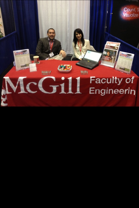 Picture of Dr. Matt Kinsella and Antonella Fratino at the McGill Bioengineering Booth at BMES 2013