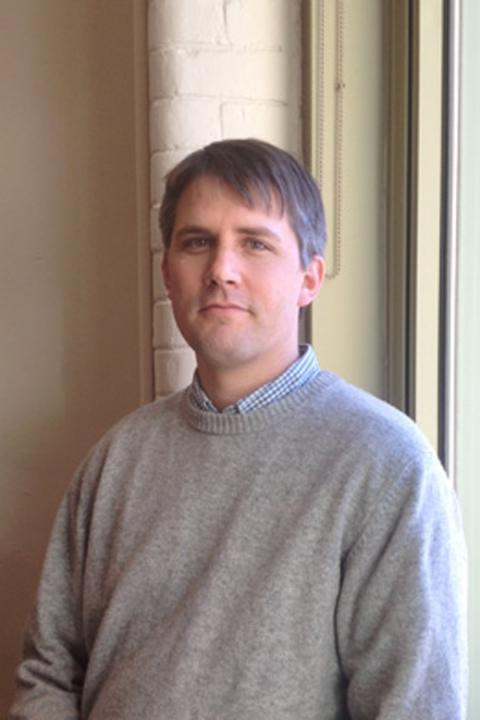 Head shot of Professor Adam Hendricks