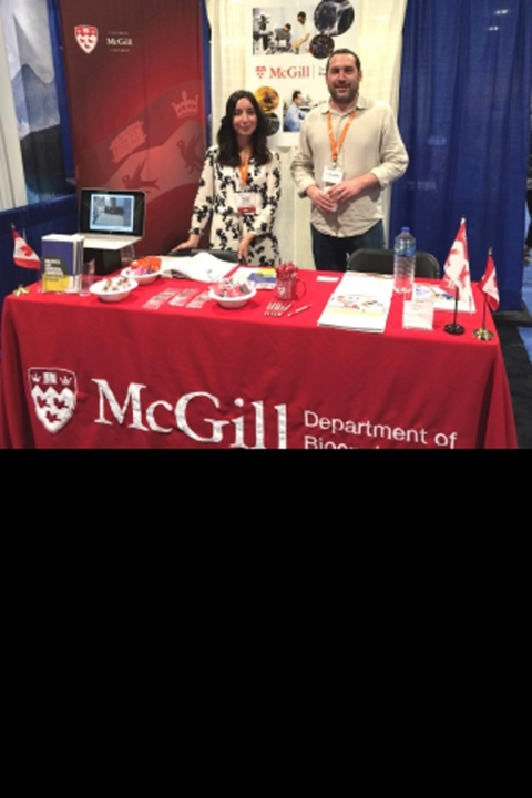Rosalie Nardelli and Prof. Matt Kinsella standing at the McGill Bioengineering booth at the Biomedical Engineering Society conference
