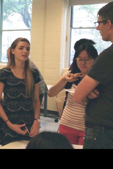 Students discussing with Prof. Adam Hendricks