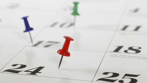 calendar with thumb tacks