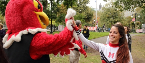 Marty the Martlet and a McGill cheerleader at a Centraide event