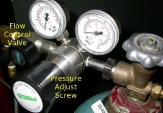 Step 14: When gauges fall to zero, turn the pressure adjusting