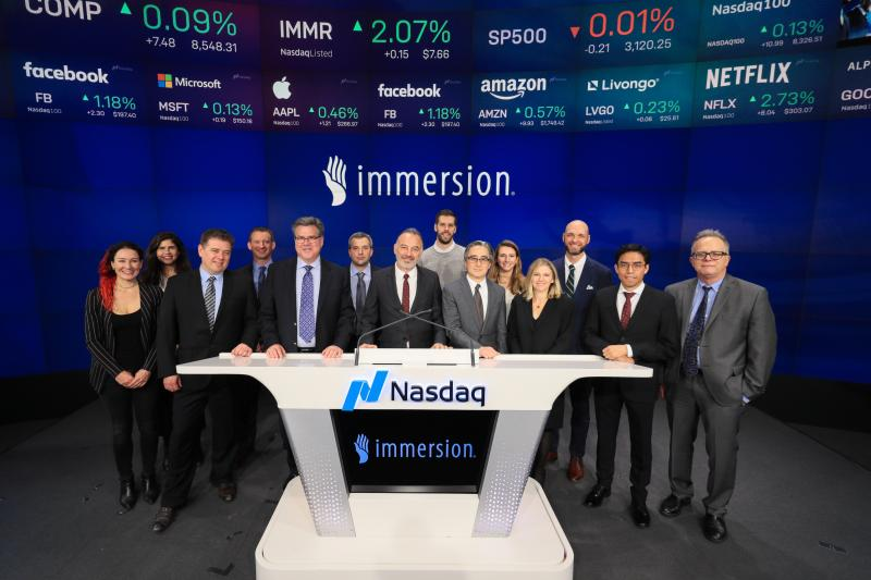 immersion members stand at Nasdaq desk