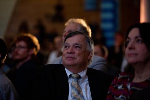 CIM professor Frank Ferrie watching a presentation