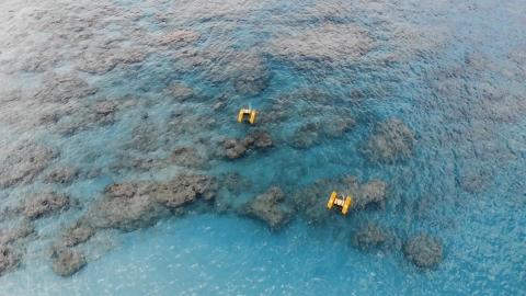 yellow robots explore a blue ocean