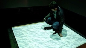 person squatting on interactive surface