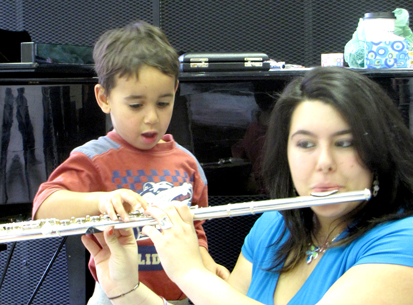 Little Musician touching flute
