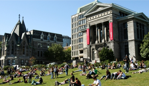 students sitting on lower campus