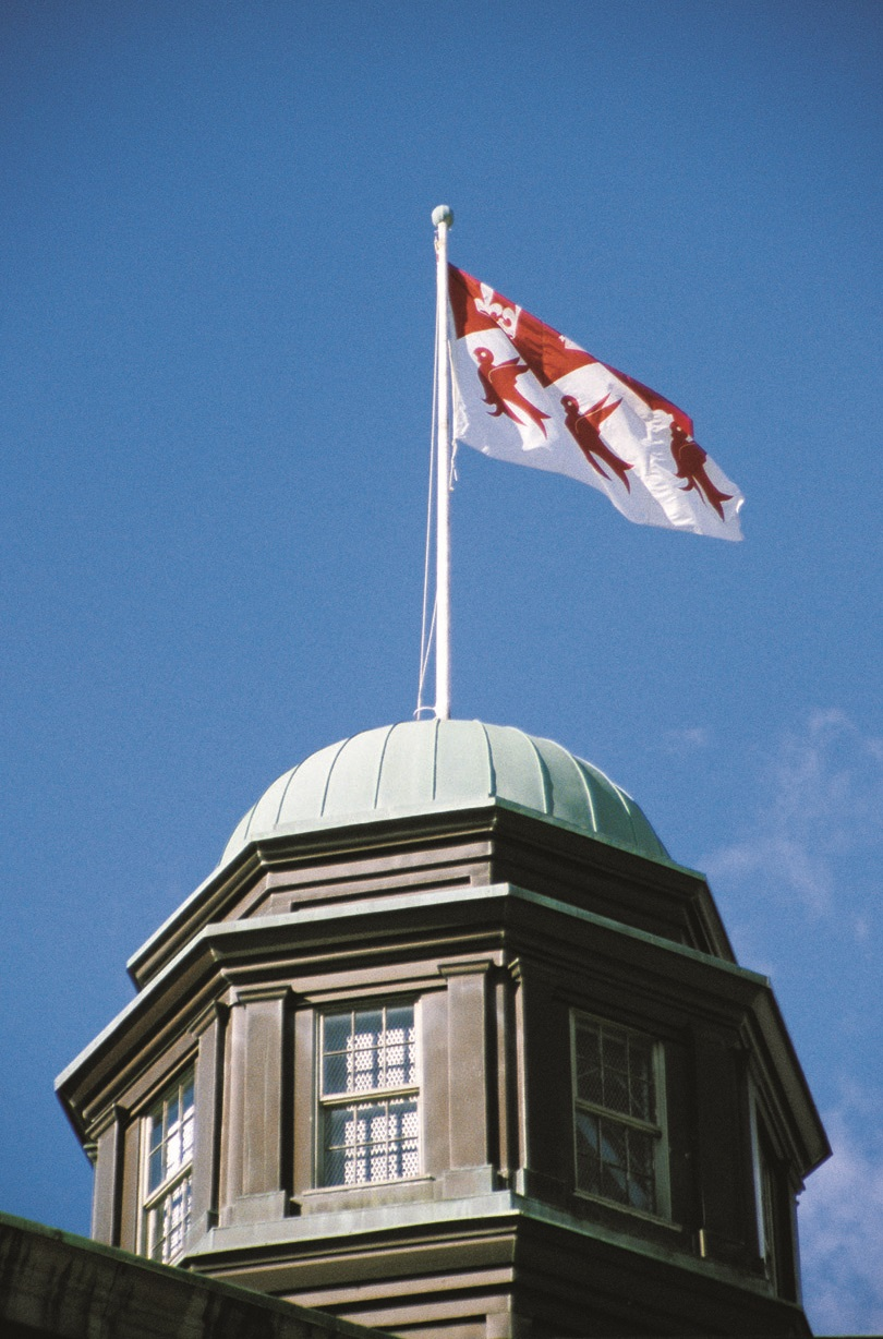 Top of McGill Arts building with McGill flag