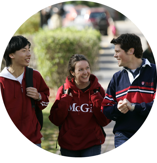 Three students wearing McGill sweaters walking on campus