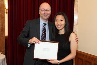 Kristina with Dean Allison receiving an award at graduation