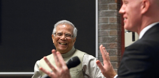 Dr. Yunus shares a laugh with Mike Ross and the audience