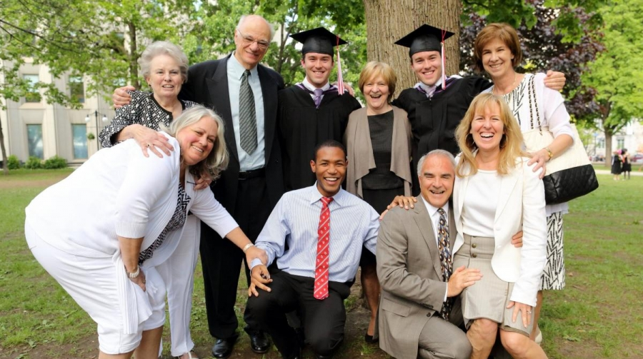 Adam Vaillancourt and Paul Vaillancourt (BCom'14) with family and Dave D'Oyen (BA'13, front-middle) (Photo: Owen Egan)