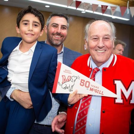 Professor Morty Yalovsky celebrates with son and grandson.