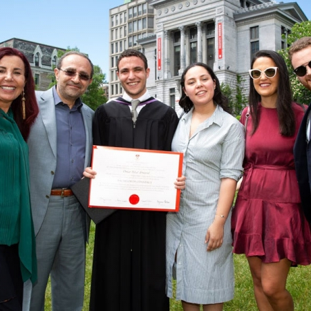 Omar Abuzeid, BCom'18, and family celebrate Convocation.