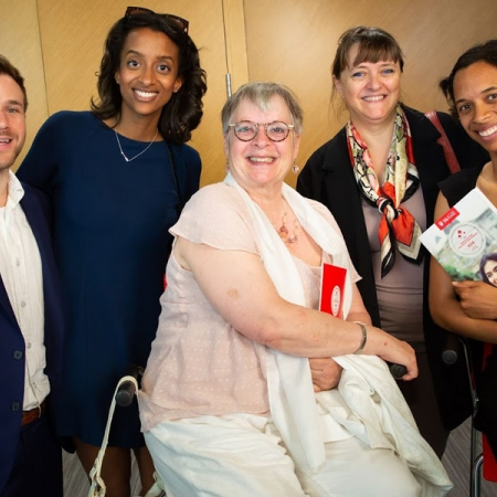 Mariama Dupuis-Sene (MBA'18), second from left, poses with family and Dean Isabelle Bajeux (second from right)