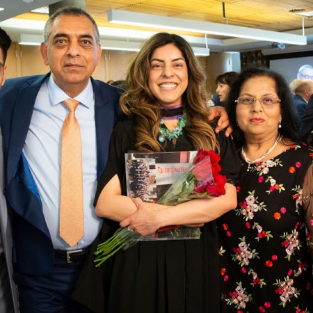 Parul Chawla (MBA'18)  is all smiles with her family