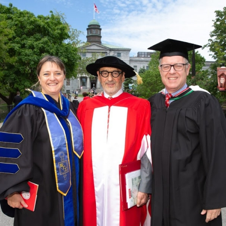 Dean Isabelle Bajeux and Vice Principal of Advancement Marc Weinstein flank Desautels' Honorary Doctorate recipient, Gerald Sheff, BArch'64, LLD'18
