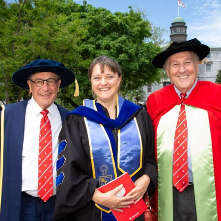 From left to right: Honorary Doctorate recipient Gerald Sheff, Dean Isabelle Bajeux-Besnainou, and Vice-Dean Morty Yalovsky at McGill's Spring 2018 Convocation.