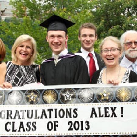 Alex Pajusi (BCom'13) and family (Photo: Owen Egan)