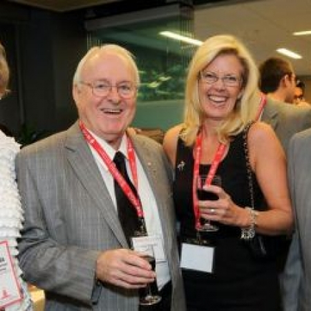 Dr. Marcel Desautels (second from left), LLD'07, Desautels Faculty of Management's largest benefactor, connects with alumni at the Dean's Reconnect Reception.