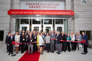Donors observe Principal and Vice-Chancellor, Suzanne Fortier, Dean Isabelle Bajeux, and Marcel Desautels (C.M., LLD'07) cut the ribbon in front of the new Donald E. Armstrong Building on May 25.