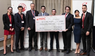 Competition organizers present the winning team from HEC Montreal with the giant cheque during the MIPC Closing Ceremony. / Photo: Edmond Chung