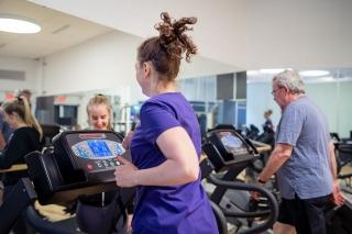 People running on treadmills.