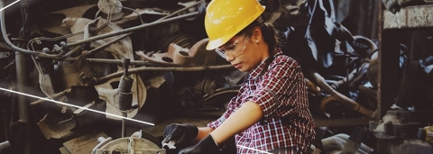 Mechanic wearing safety equipment and working in a workshop