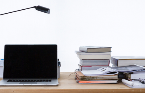Laptop and books on a table