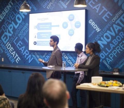 Ora-3D team presenting a powerpoint