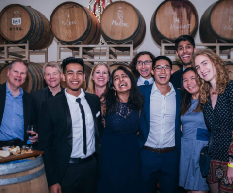 Cansbridge fellows smiling in front of barrels