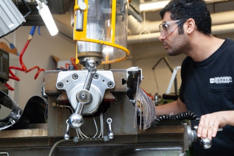 a technician working on a cutting machine