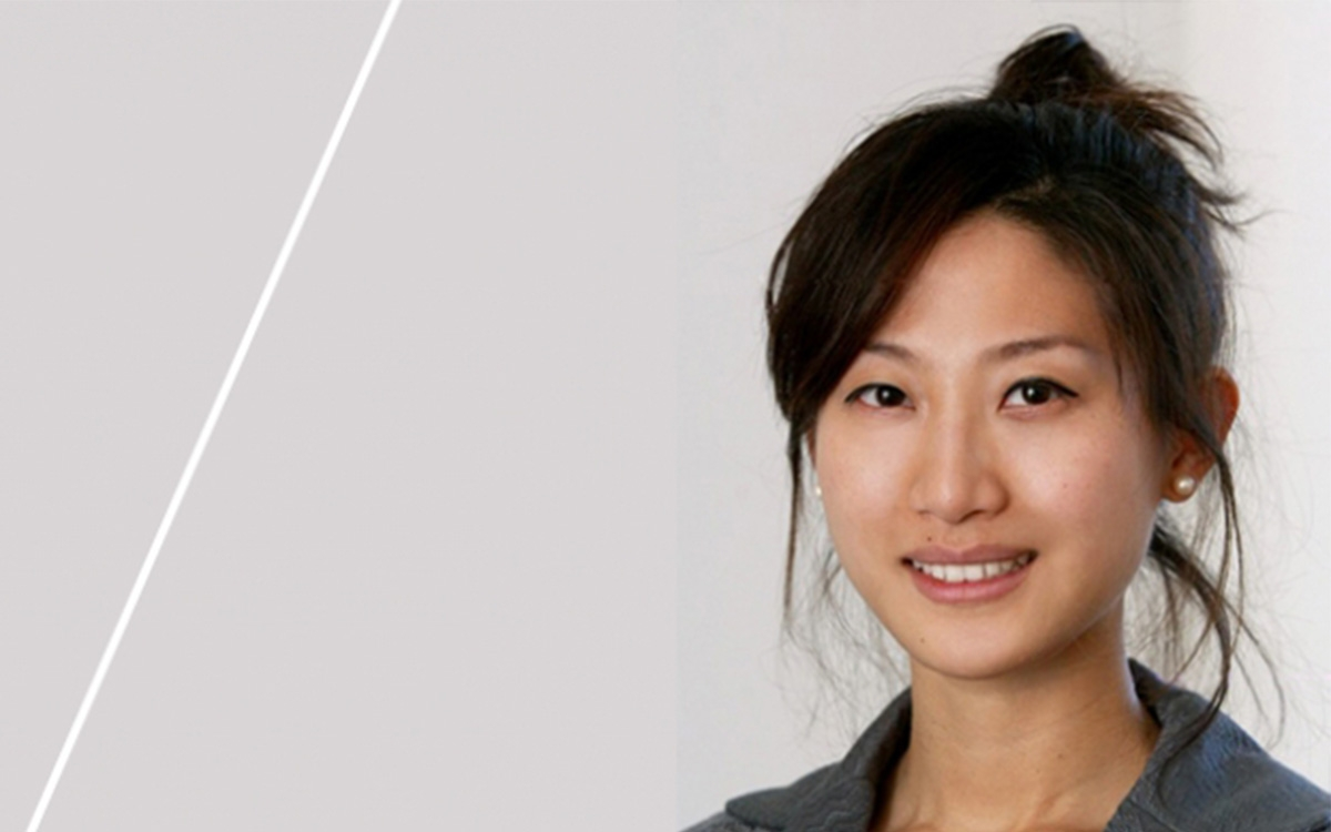 a headshot of Prof.Mary Kang in light grey background