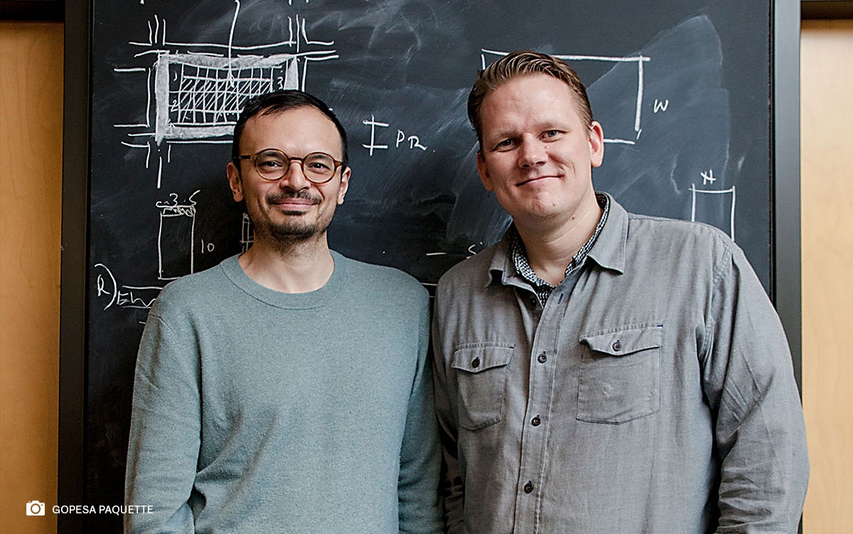 Prof. Salmaan Craig (left) and Prof. Kiel Moe (right) standing in front of a backboard