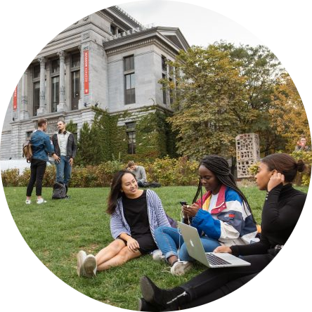 Students sitting in the front lawn of McGill downtown campus